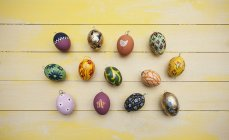 Hand painted easter eggs on wooden table — Stock Photo