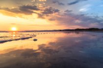 Scenic view of sunset at the beach, Campo di Mare, Italy — Stock Photo