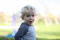 Portrait of surprised blond little boy outdoors — Stock Photo