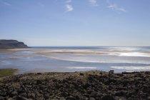Iceland, Raudasandur, Westfojords, scenic view of sea shoals seen from rocky beach — Stock Photo