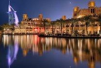 Scenic view of fascinating Dubai skyline at night, UAE — Stock Photo