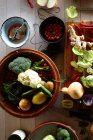 Fresh Vegetables and oysters on kitchen table, top view — Stock Photo