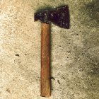 Hammer wood chopper on concrete textured surface — Stock Photo