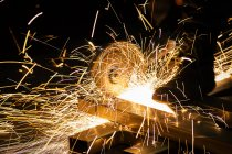 Sharpening and cutting of iron by an abrasive disc machine — Stock Photo