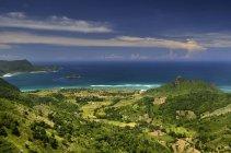 Indonesia, Serangan, beautiful landscape with green hills and sea — Stock Photo