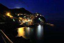 Village illuminated at night, Manarola, Cinqueterre, Liguria, Italy — Stock Photo