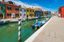 Italy, Venice Province, Burano, Colorful houses by canal — Stock Photo