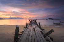 Beautiful sunset Jetty at Black Sand Beach Village in Langkawi Island, Malaysia. — Stock Photo