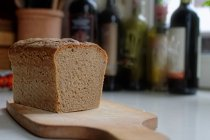 A loaf of homemade sourdough bread on a chopping board — Stock Photo