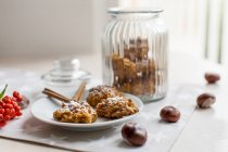 Oatmeal and pumpkin biscuits over kitchen table — Stock Photo