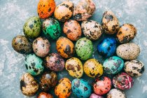 Close-up of multi-colored Easter eggs over weathered background — Stock Photo