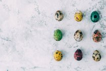 Top view of Multi-colored Easter eggs over weathered background — Stock Photo