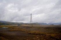Линия электропередачи в сельской местности, Исландия — стоковое фото