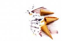 Ice cream cones and melted ice-cream closeup — Stock Photo
