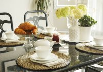 Croissants on a served Breakfast table at home — Stock Photo