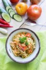 Closeup view of pasta in bowl with vegetables and shrimps — Stock Photo