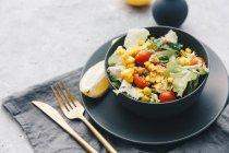 Closeup view, black bowl of fresh tasty salad salad — Stock Photo