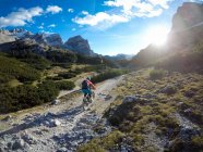 Woman riding mountain bike at Fanes Sennes National Park, Italy — Stock Photo