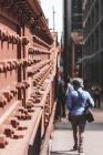 A pedestrian walking across a bridge, Chicago, Illinois, United States — Stock Photo