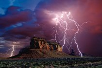 Omposition of a lightning storm near Eagle Mesa in Monument Valley Arizona, usa — Stock Photo