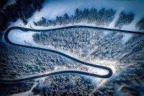 Aerial view of winding road through mountains in winter, Salzburg, Austria — Stock Photo