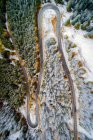 Aerial view of switchback road through a winter forest, Bavaria, Germany — Stock Photo