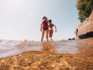 Boy and girl walking in a lake, Lake Superior, United States — Stock Photo