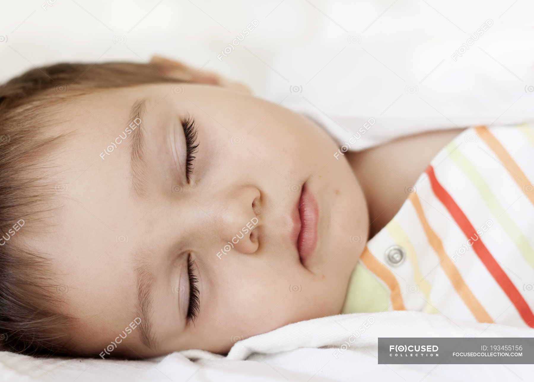Close Up Of Sleeping Baby Girl In Bed Innocence Detail Stock Photo 193455156