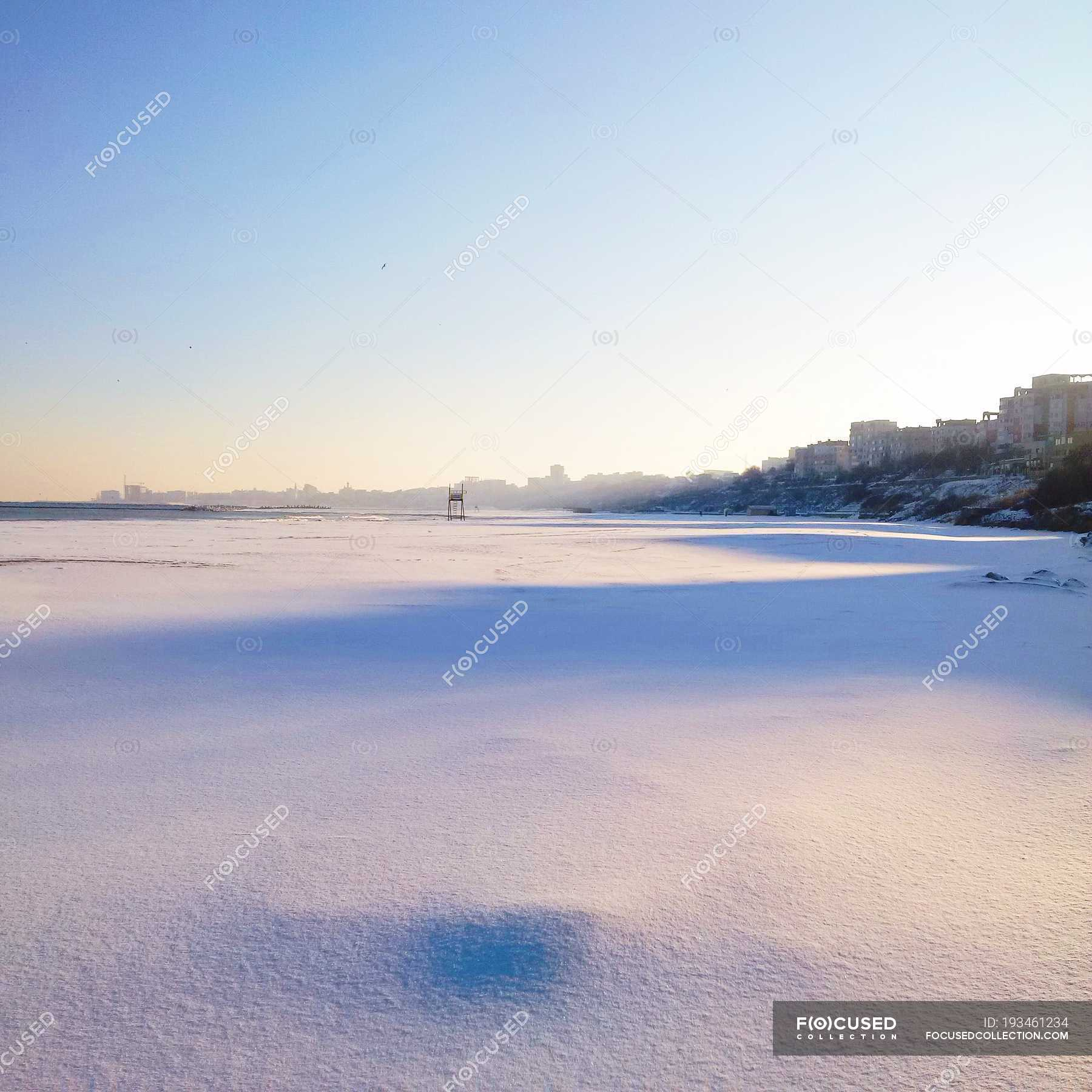 Scenic View Of Snow Covered Beach