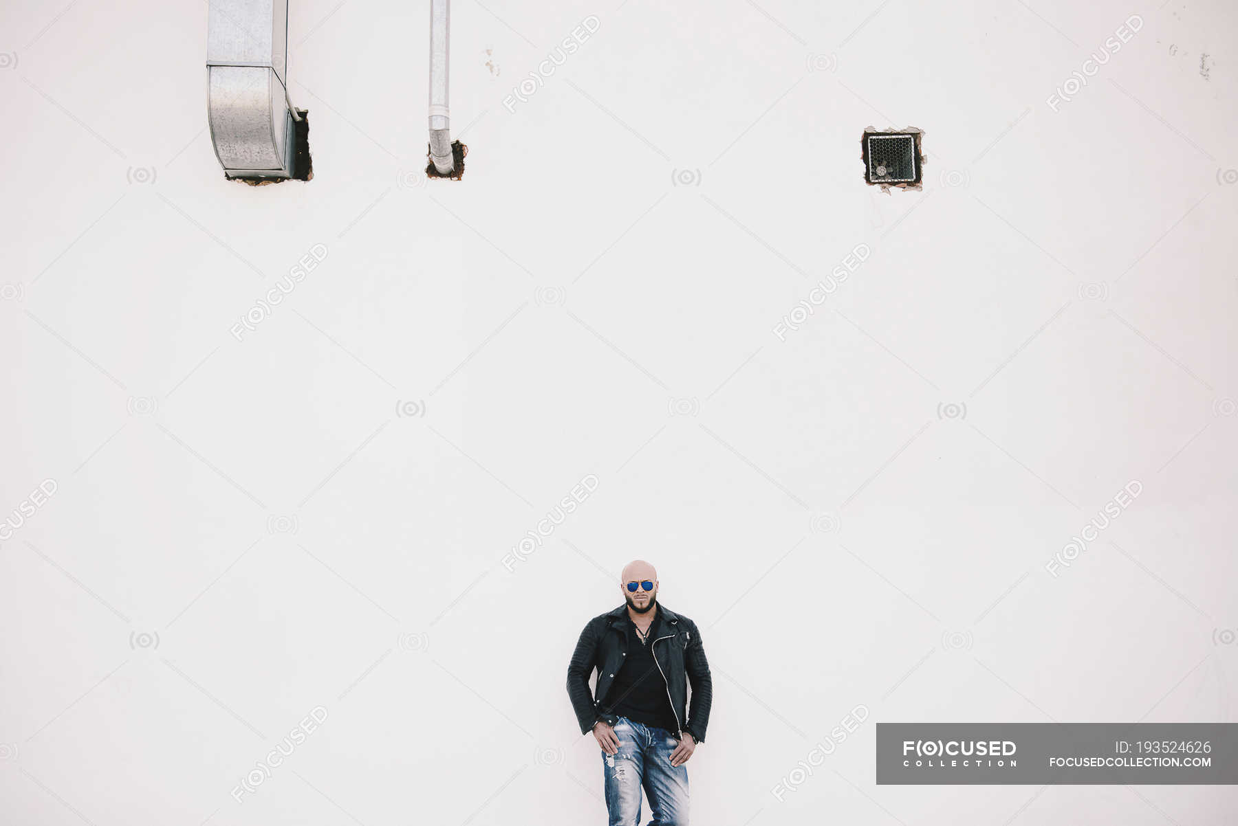 Cool Man Standing In Front Of White Wall Masculinity Striding Stock Photo 193524626