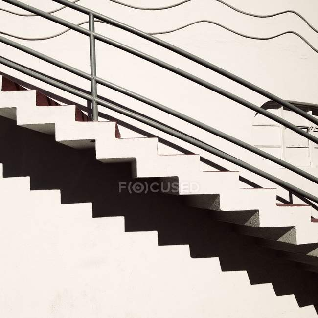 White staircase with shadow — Stock Photo