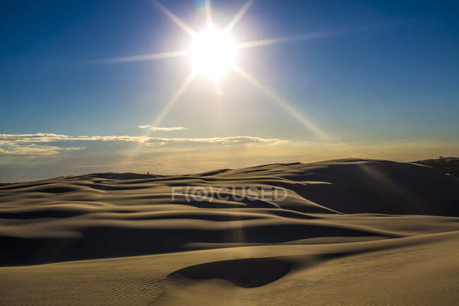 Sun shining under desert — Stock Photo