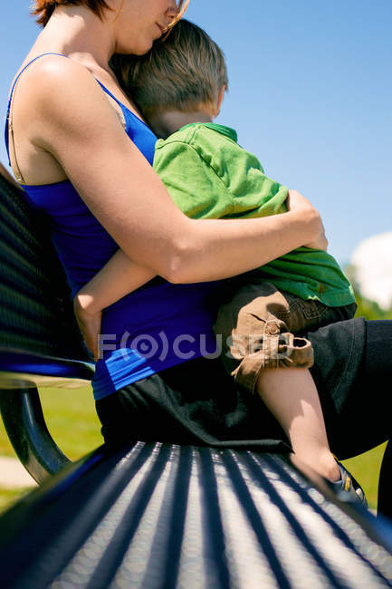 Woman holding little son — Stock Photo