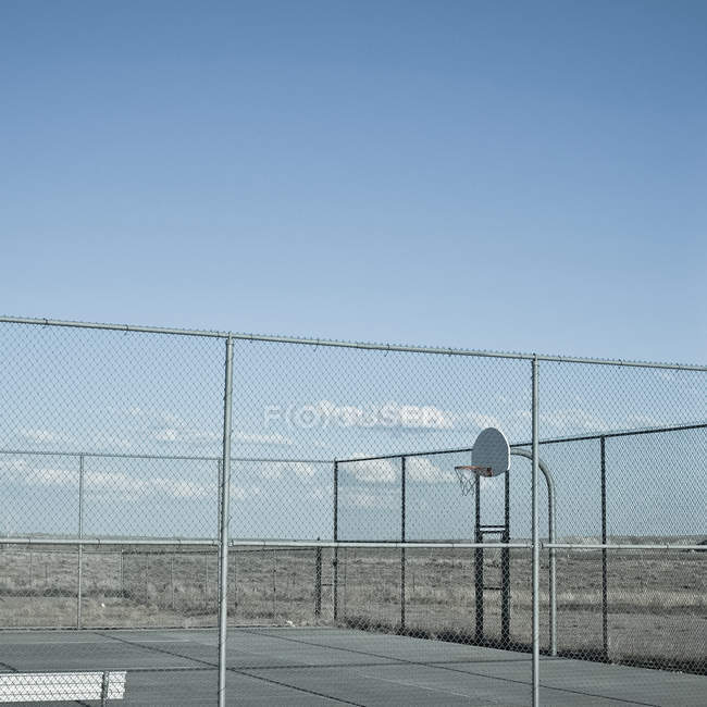 View of outside basketball court in desert — Stock Photo