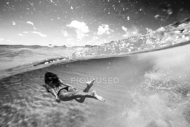 Woman swimming underwater in sea — Stock Photo