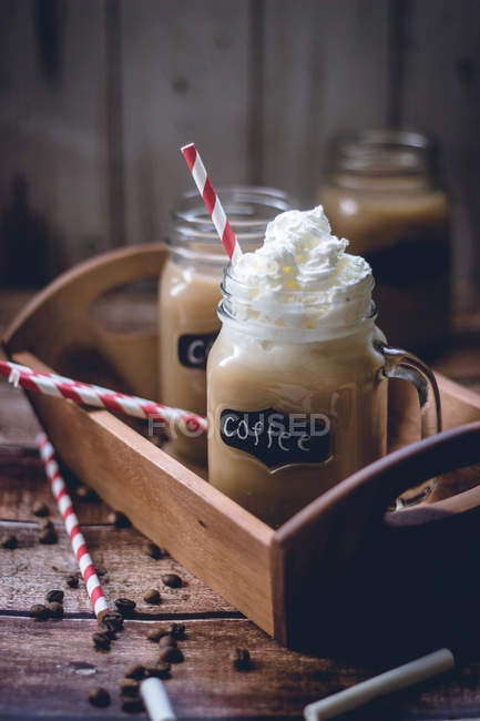 Coffee and cream in glass jar — Stock Photo
