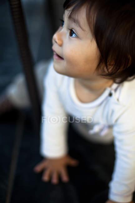 Girl looking through window — Stock Photo