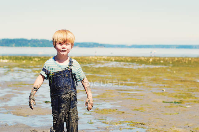 Boy covered in mud — Stock Photo