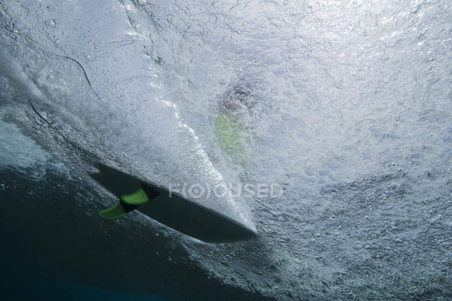 Surfing board view from underwater — Stock Photo