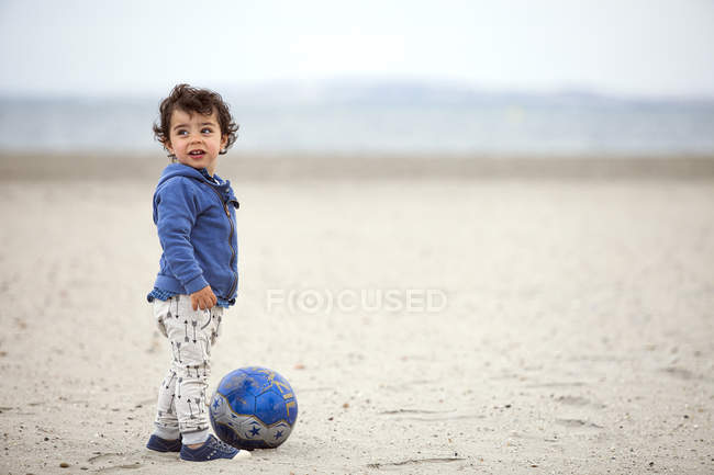 Little child on beach with ball — Stock Photo