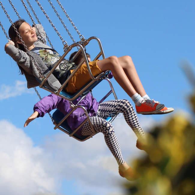Girls having fun on carousel — Stock Photo