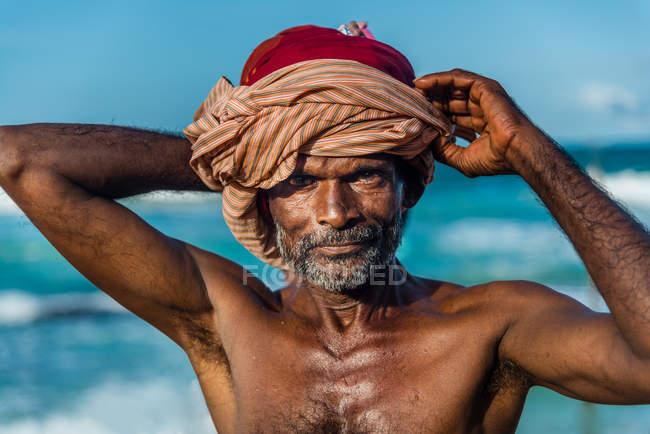 Asian fisherman on beach — Stock Photo