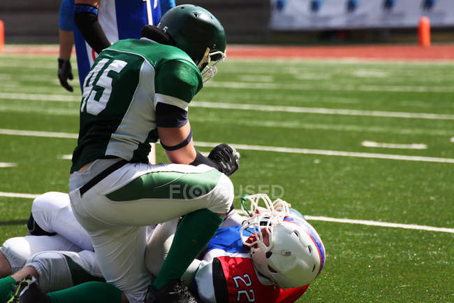 Two men playing American football — Stock Photo