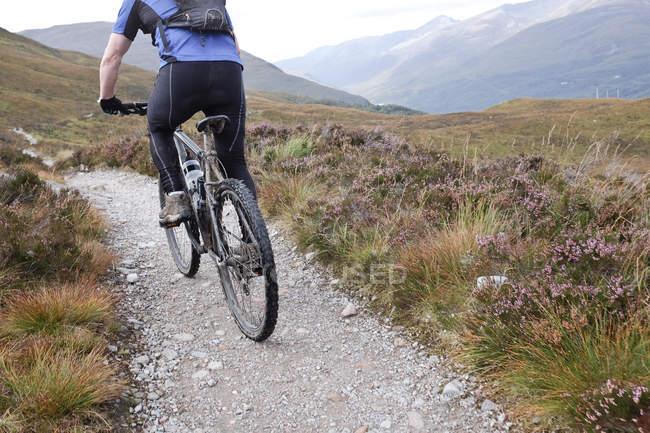 Man mountain biking along trail — Stock Photo