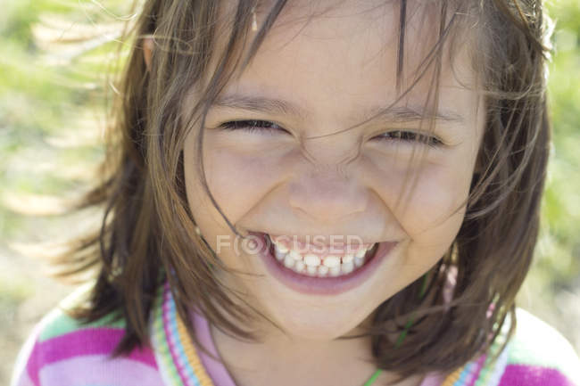 Little girl smiling at camera — Stock Photo