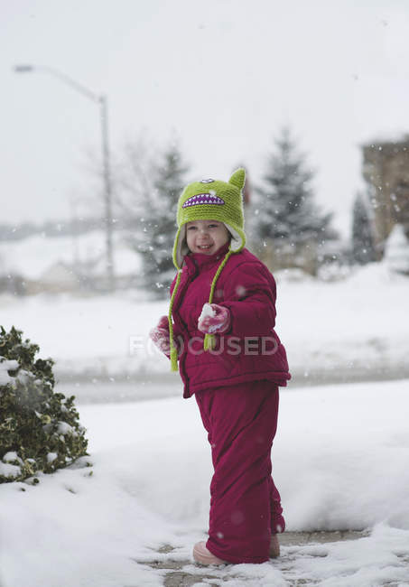 Toddler girl with snowflake — Stock Photo