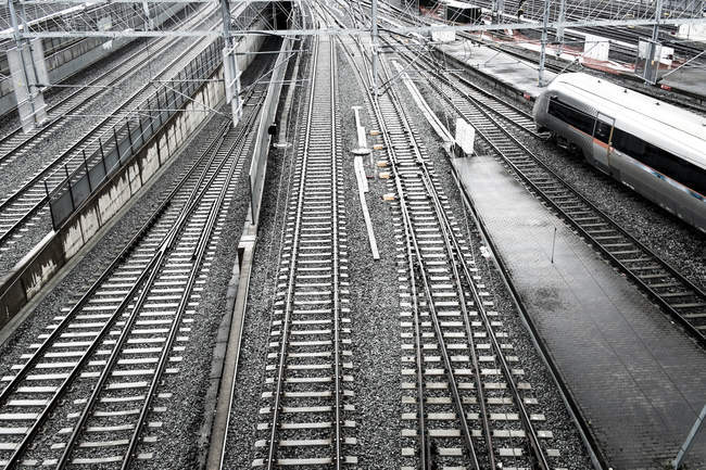 Railway tracks with passing high-speed train — Stock Photo