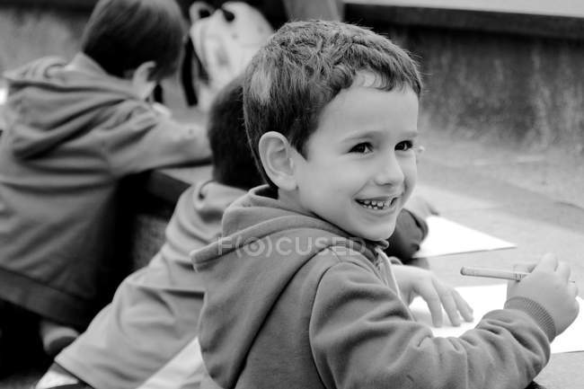 Happiness boy smiling while drawing — Stock Photo