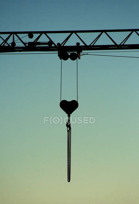 Crane jib with heart shaped pulley — Stock Photo