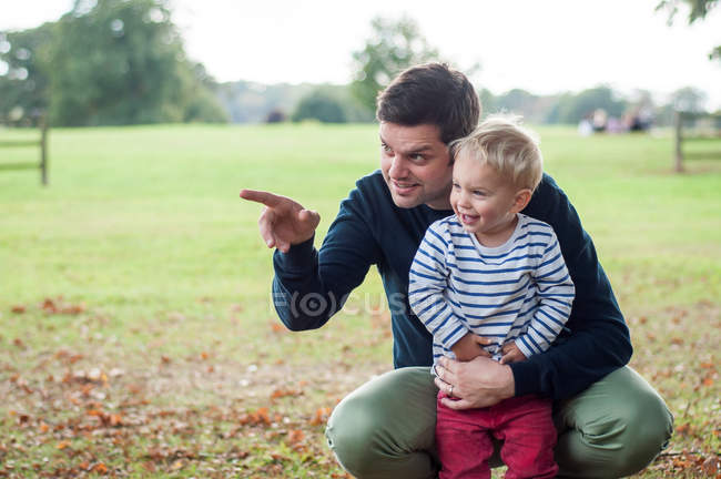 Father hugging son in park — Stock Photo